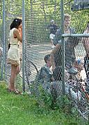 Girl Against Fence