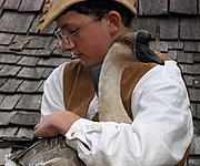 Teenage Boy in Costume Holding a Goose