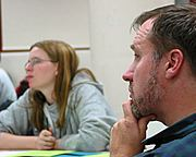 Man Listening at a Community Ed Meeting