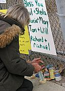 Woman Lighting Candle, Wellstone Memorial