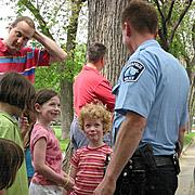 Children Talking with Police Officer