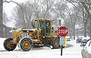 Plowing in a Snowfall