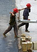 Construction Workers Carrying Beam