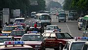 Taxis and Buses on Jianshe Road, Shenzhen, China