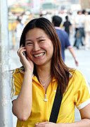 Woman Smiling, Talking on Cellphone