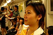 Woman Standing Riding the Subway