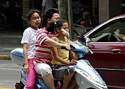 Woman on a Moped with Girls, Shanghai
