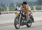 Man and Boy on a Motorcycle, Yueqing