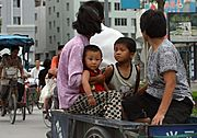 Family Riding in a Bike Wagon, China