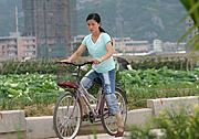 Young Woman on Bike, Yueqing, China