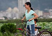 Girl on Bike Smiling