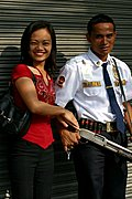 Woman with Bank Guard, the Philippines