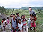 Westerner with Native Children, The Philippines