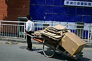Chinese Man Pulling Cart