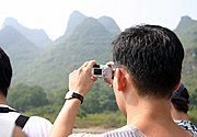 Man Taking Picture, Li River Cruise, China