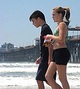 Kids Walking Together on a Beach