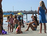 Woman and Kids on Crowded Beach, Oceanside