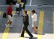 Businessman on Cell Phone in Crosswalk, Hong Kong