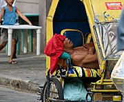 Filipino Man Sleeping in a Sidecar