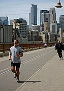 Runner on Path Over the Stone Arch Bridge