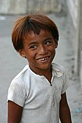 Boy Smiling on Manila Street