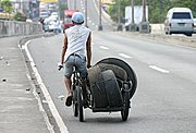 Man Hauling Tires on Manila Freeway