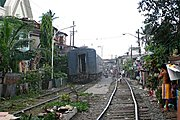 Train Rumbling Through Manila Neighborhood