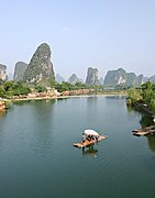 Karst Mountains and Couple on River Raft