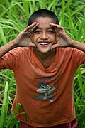 A Boy in the Weeds, Looking up and Smiling