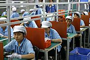 Rows of Electronics Workers