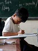 Filipino Boy Doing Schoolwork in Class
