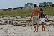 Father and Daughter, Walking on the Beach