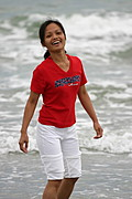 Asian Woman Smiling on the Beach
