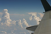 Clouds, Sky, and Wing During Airline Flight