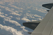 Rolling Clouds and Aircraft Wing
