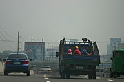 Truck with Workers on the Freeway into Manila
