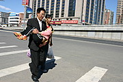 Man Carrying Young Child, Beijing, China