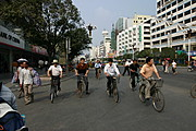Bike Commuters at an Intersection in China