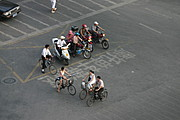 Scooters, Motorcycles, and Bicycles at an Intersection in China