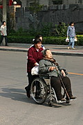 Older Chinese Woman in Wheelchair, Road in Beijing