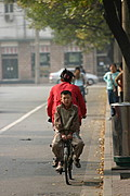 Young Boy Riding on the Back of a Bicycle, Beijing