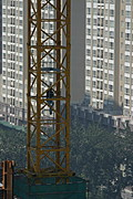 Worker Climbing Construction Crane, Beijing, China
