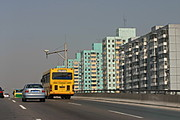Beijing Freeway with Yellow Bus and High-Rises