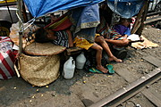 Street Kids Sleeping near Rail Road Tracks in Manila