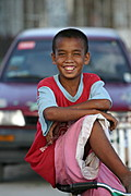 Image of a Street Boy on a Bicycle Smiling