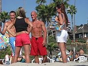 Young Guys and Girls Talking at the Beach