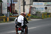 Two Filipino Friends Riding a Scooter in Balibago, Angeles City, Pampanga