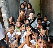 Chris Amidst the Poor Children in Balibago, Angeles, Pampanga, Philippines