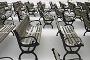 Rows of Empty Benches in Winter