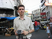 A Foreign Photographer Searches for the a Good Shot in Quiapo